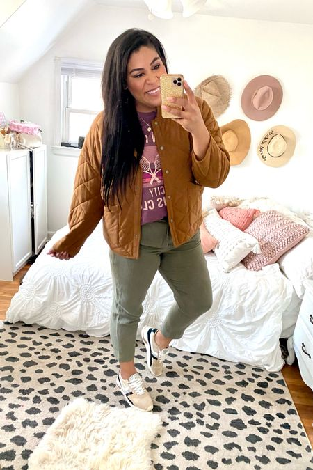 30 days of wear now, wear later midsize outfit ideas for fall!  These linen pants are so lightweight + come in multiples colors + are ON SALE! Use code MORE at Loft — wearing a size L   wear later: with a $15 graphic tee from Target (Size up for oversized, XXL) and a quilted cognac coat from Walmart fashion (TTS, XL)   midsize, mid size, plus size, casual outfits, size 12, size 14, affordable fashion, transitional style, midi dress, casual dress, fall coat, fall outfit ideas, linen pants, casual pants, olive green, loft   #LTKunder50 #LTKcurves #LTKSeasonal