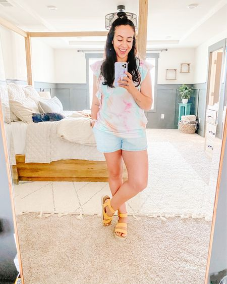Livin' in this tie dye tee for the summer! One of my favorite Amazon finds! It's a thicker material—not see through ☀️ and sleeveless with the cutest ruffles on the shoulders. I am wearing a size large for reference!   These Target sandals are the perfect match and are so comfy. They are more comfortable than my black Steve Maddens and half the price 😜 wearing a size 10 ♥️    http://liketk.it/3iLNu #liketkit @liketoknow.it Shop your screenshot of this pic with the LIKEtoKNOW.it shopping app ☀️