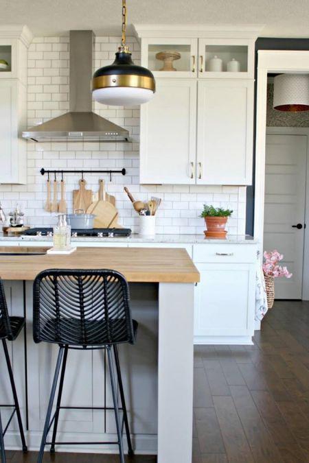 Our white farmhouse kitchen with black barstools, black and gold pendant lights, neutral kitchen accessories, farmhouse decor, and more! Farmhouse kitchen, kitchen barstools, barstool roundup, best kitchen decor, kitchen organization. http://liketk.it/3ozJu   @liketoknow.it #liketkit @liketoknow.it.home #LTKstyletip #LTKhome #LTKunder100