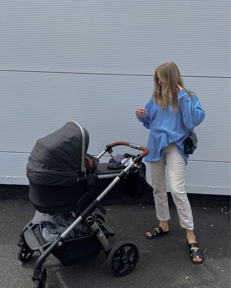 New mum style, free people blue thermal top, oversized top, casual outfit, cream jeans outfit, black sandals , black pram , silver cross pram @liketoknow.it #liketkit http://liketk.it/3mx6f #LTKfamily #LTKeurope #LTKbaby