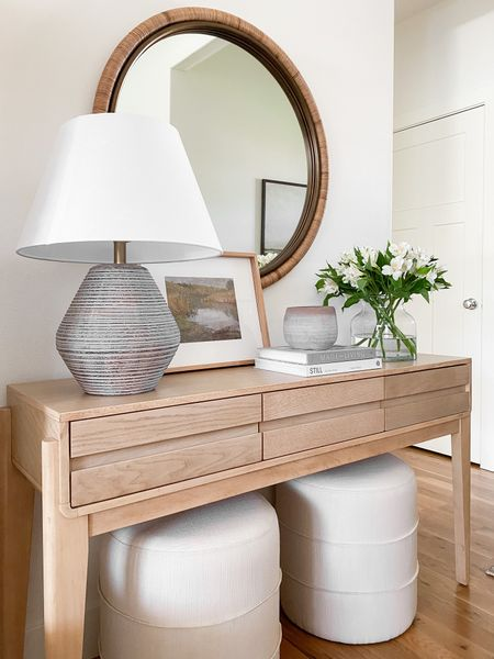 Console table styling ideas perfect for your entryway or living room.  Vase, lamp, ottomans, round mirror, artwork and decorative objects.    You can instantly shop my looks by following me on the LIKEtoKNOW.it shopping app http://liketk.it/3gSVk @liketoknow.it #liketkit @liketoknow.it.home   #LTKunder50 #LTKhome #LTKstyletip