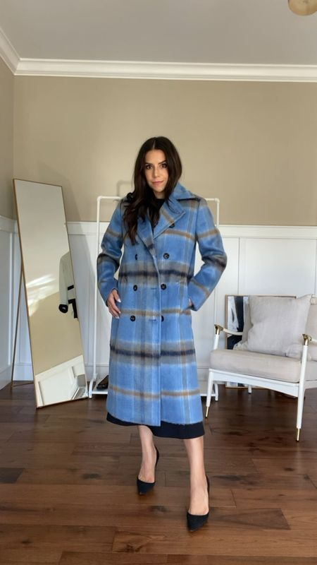 Wearing XS regular, not petite. It's currently 40% off! Extremely warm and lined coat! Such a great find for fall/winter.