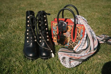 Boots and bling is a chic thing.  I see combat boots make the cutest spring and summer outfits.  Pair these perfectly with dresses, skirts and shorts for a fashion forward look.  Take your look to elevate heights with a bit of bling.  It can be a subtle, simple necklace or eclectic pairing of a printed handbag and printed scarf.    #LTKshoecrush #LTKstyletip #LTKitbag