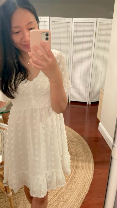 """I had to have this little white dress after seeing it on my friend @anniemaithai. Wearing size S. Dress is 100% polyester, lined and comes in other colors. Size S has a 26"""" waist where the smocked portion ends. Amazon find.   #LTKSeasonal #LTKunder50 #LTKwedding"""