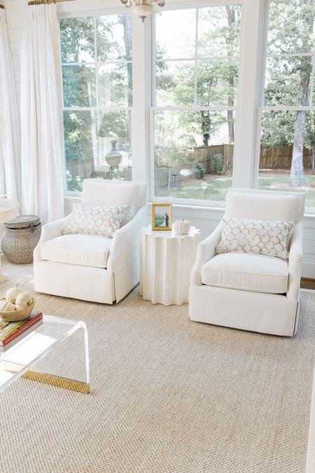 fall decor in the living room // swivel chair, jute rug, column side table, gold picture frame, white pumpkins, glass coffee table, blanket basket http://liketk.it/2XdMt #liketkit @liketoknow.it #LTKhome #LTKunder100 #LTKunder50
