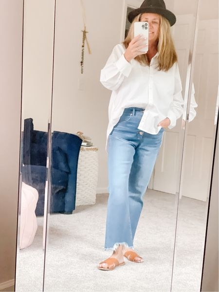 """So @loft is having a sale.  I haven't purchased jeans in a while and I'm really liking these button front frayed jeans.   Add an oversized  boyfriend shirt, some accessories and your styled.  I hear It's a #trend this season to have cropped jeans at least two inches above your ankle to see your """"booties"""".  Well petites it is.   New booties coming soon - stay tuned!"""