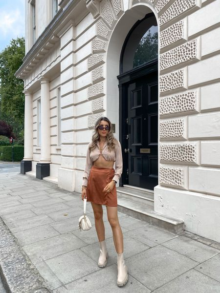 How gorgeous is this Missguided brown satin wrap skirt for autumn? It's under £30 too! I've already worn it on a night out with the matching bralet but think it will look so cute for autumn layered with a chunky knit. I've accessorised with nude ankle boots and my Coach tabby pillow shoulder bag 🍂  #LTKeurope #LTKunder50 #LTKunder100
