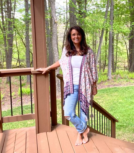 A floral short-sleeve kimono style jacket from Target. The open front makes it great for layering your Summer outfits. It can also double as a beach cover up during your beach vacation! Lightweight and breezy with tassel detailing on the hem.  #kimbentley #targetstyle #competition.   #LTKSeasonal #LTKstyletip #LTKswim