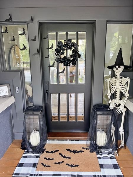 H A L L O W E E N \ And so it begins… things are getting a little SPOOKY around here!!🦇 Say hello to Mr. Bones!!👋🏻💀Setup my front door decor today including a few of my all time favorite Halloween items - bats, layered door mat and pumpkins! I also did a festive witch hat DIY setup! Coming to SBKliving.com this weekend✨  Nighty night, BOOS👻  Shop my setup NOW over on the LTK app! Click the link in my bio🧙🏻♀️ #sbkliving  #halloween #halloweendecor #fall #falldecor #halloweenporch #porch #doordecor  #LTKunder50 #LTKhome #LTKSeasonal