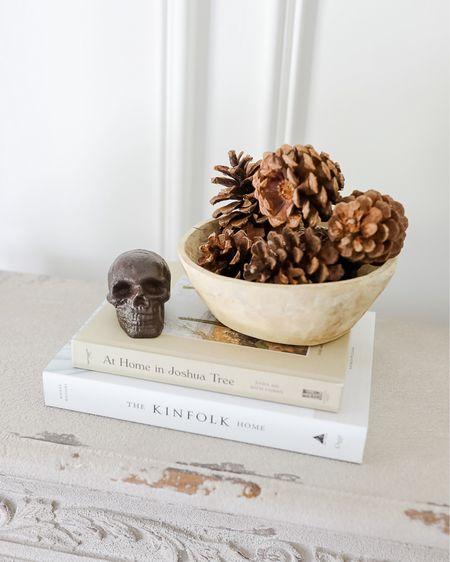 fall decor, halloween decor, fall decorations mantle, skull decor, wooden bowl, faux pinecones, neutral halloween decor http://liketk.it/2X8zV #liketkit @liketoknow.it #LTKhome #LTKunder100 #LTKunder50 #LTKfall