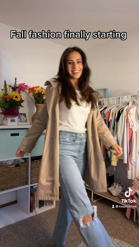 Fall fashion outfit, wearing viral Abercrombie and Fitch straight leg ripped jeans (90s ultra high rise), cream colored tank top and tan trench coat. Very trendy, simple outfit for fall 2021  #LTKSeasonal #LTKfit #LTKstyletip