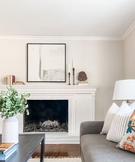 Love this neutral artwork over the white fireplace.  Affordable art, living room decor, fireplace decor, large art, neutral art, mantle style  #LTKhome