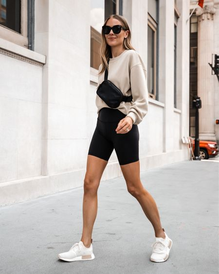 """Love these black biker shorts from lululemon. Fit tts and these are the 8"""" length. They are INCREDIBLY comfortable. Sweatshirt color is trench and wearing a 4 (tts)   #LTKfit #LTKstyletip #LTKunder100"""