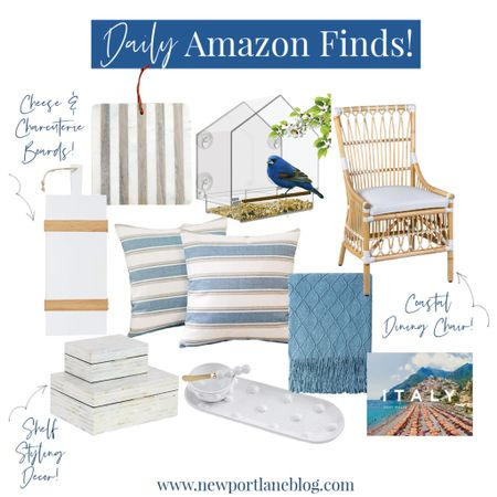 Shop my daily Amazon home decor finds!    http://liketk.it/3beyz #liketkit @liketoknow.it @liketoknow.it.home #LTKhome #StayHomeWithLTK #LTKunder100 acrylic bird feeder, marble cheese board, striped charcuterie board, etú home board, blue blanket, serving tray. Rattan dining chair, coffee table book, striped pillow covers