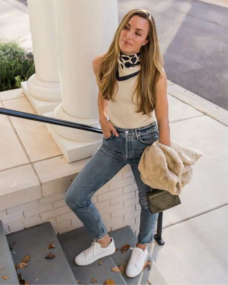 White Sneakers, Casual Fall Outfits, White Bodysuit, Casual Outfits  Fall casual outfits are my go-to for the weekends! 🍂 This neck scarf under $100 can be styled so many ways, Citizens of Humanity straight leg jeans run a tad snug, faux fur jacket is TTS and under $100, and Ethyl sneakers are TTS and very comfortable (also under $100!).  #straightlegjeans #whitesneakers #casualoutfits #falloutfitideas #momjeans #jeans #falloutfits #falloutfitswomen #momjeansoutfit #falljacket #falloutfitscasual #jeansoutfit