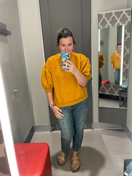 I love the details on this puffy sleeve embroidered  mustard sweatshirt! I would definitely need to size down but the store didn't have my size.   There's also a similar non embroidered top at another store I linked as well.   #LTKcurves #LTKbacktoschool #LTKunder50