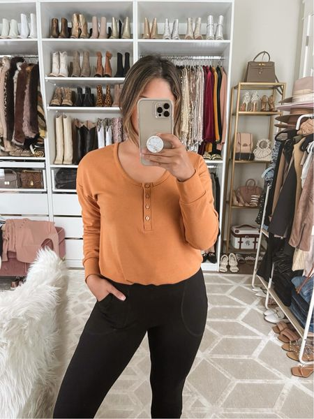 """This Cropped Henley with Drawcord Bottom   I'm wearing in """"Sedona"""" is paired with the Fitted High Waisted Joggers that come in """"Black"""" I designed with @gibsonlook  Code: HAUTE15 for 15% OFF!  Henley top: Size down Fitted joggers: TTS  Notes: The Henley top buttons are functional so it is nursing friendly! The hidden drawstring allows you to wear it more cropped or loose to your body. Comes in 2 other colors """"Pink Sandstone"""" & """"Black""""   The joggers fit more like high waisted leggings with a thick ponte fabric that will keep you warm in the fall and feature side pockets & is cuffed at the ankle!  #fallfashion #falloutfit #loungewear #henleytop #bumpfriendly #nursingfriendly #matchingset  #leggings #highwaistedleggings #fittedjoggers   #LTKHoliday #LTKunder100 #LTKsalealert"""