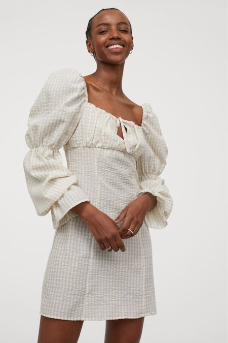 H&M dress - Short fitted dress in woven fabric with a square neckline and gathered seam at the bust with a small opening and ties at the top. Long puff sleeved dress - puff sleeve dress - tie front dress - beige dress - check dress - white dress - cream dress - summer dress - spring   #LTKstyletip #LTKunder50 #LTKeurope