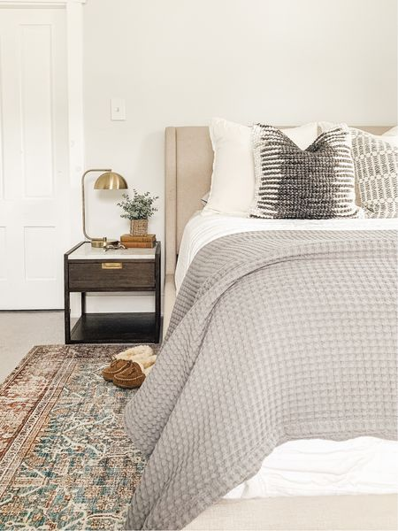 Guest Bedroom. Wood and marble nightstand, vintage rug, neutral pillows.   #LTKhome