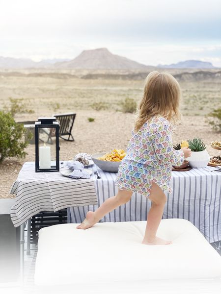 """Little Biz """"helped"""" me set the table tonight. She is wearing and old Roller Rabbit tunic and I tagged our new favorites here. She wears them as a swim cover up and also as pajamas.   #LTKbaby #LTKkids #LTKhome"""