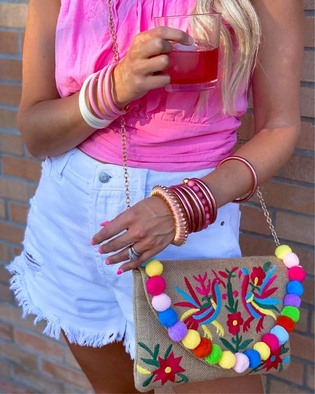 Budha girl bracelet stacks on sale for the next week - 20% off will be automatically applied!  All different shades and you can add some beaded bangles and mix and match colors!  Target high waisted shorts TTS $15  Pink crop top only $32 size Comes in white   Colorful clutch with a chain $38   http://liketk.it/3jlAK #liketkit @liketoknow.it #LTKsalealert #LTKunder100 #LTKunder50