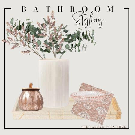 Fall bathroom decor with blush accents  This could easily be used as dresser decor in a girls bedroom, a kitchen island or a console table.  Mercury glass vase   pumpkin candle   eucalyptus stems   faux florals   fall home decor   mauve home decor  #LTKunder50 #LTKhome #LTKSeasonal