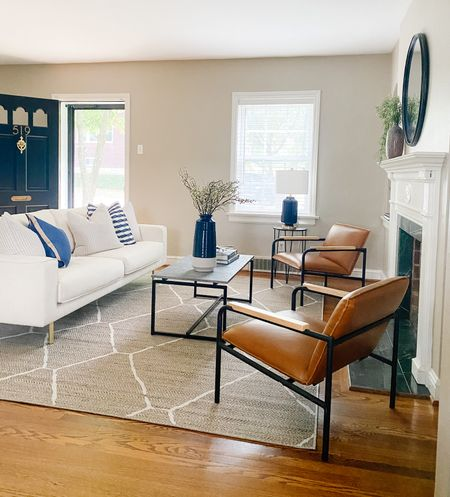 Beautiful living room decor with white sofa and faux leather chairs.  White couch, living room decor, leather chairs, faux concrete table, coffee table, jute rug  #LTKhome