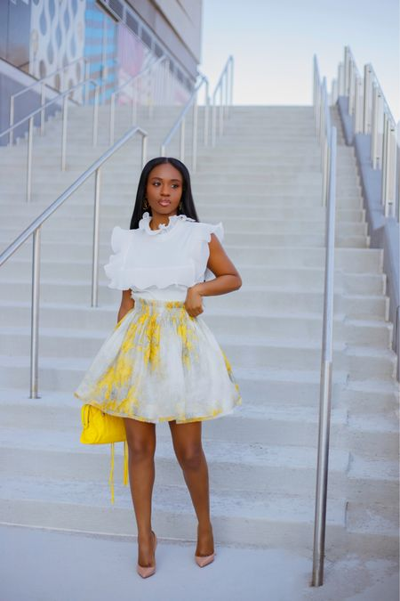 Girly, Fun & Flirty Today....Styled this skirt with yellow and white. Swipe left and let me know which one's your favorite.  Details of this outfit in on my blog {link in bio}  . .  #liketkit #ootd #floralskirt #springfashion  http://liketk.it/3fE0g  #zimmerman #LTKfit #LTKstyletip @liketoknow.it