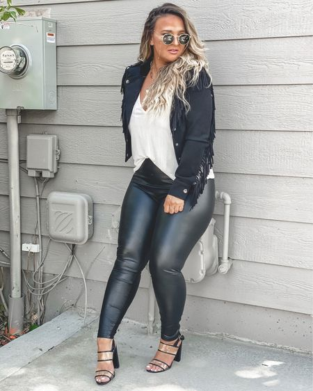 Fringe all day everyday! I have an obsession with fringe 😳 this suede black fringe jacket from @justfabonline is one of my favorite pieces I own! I seriously need this in the brown color too!! These heels are super comfortable and I love the PVC look!  I am in my usual 7.5. These leather leggings are part of the @nordstrom #nsale   Thanks to @justfabonline for these pieces! #justfabpartner #sponsored 1️⃣ Download the @liketoknow.it app and follow me @ delaynadenaye 2️⃣ Screenshot my photos and open up the app — all product details will automatically pull up. http://liketk.it/2VypH X #liketkit #LTKcurves #LTKsalealert #LTKunder50 #LTKunder100