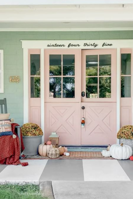 An easy way to decorate your porch tor fall is by adding lots of layers: rugs, pumpkins and a throw! These fake mums are our fav🤫    #LTKhome #LTKSeasonal #LTKunder100