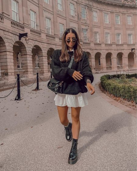 Autumn outfits Black knitted jumper  White shirt dress Doc marten  Coach tabby pillow   #LTKshoecrush #LTKstyletip #LTKeurope