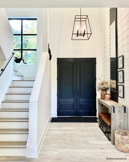Our entry doors are solid black but often seem blue in pics because they have lots of natural light reflecting off them. They're a true black color though - same as our windows, mirror and gallery frames. If you're new to our page, please note that we always share sources for everything in our pics on our website and each room in our home has it's own product sources page where you can find everything from the room listed out in detail! Link to our website is in my bio. (Cat cameos by Mocha & Nyx)  —Shop your screenshot of this pic with theShop.LTKapp.