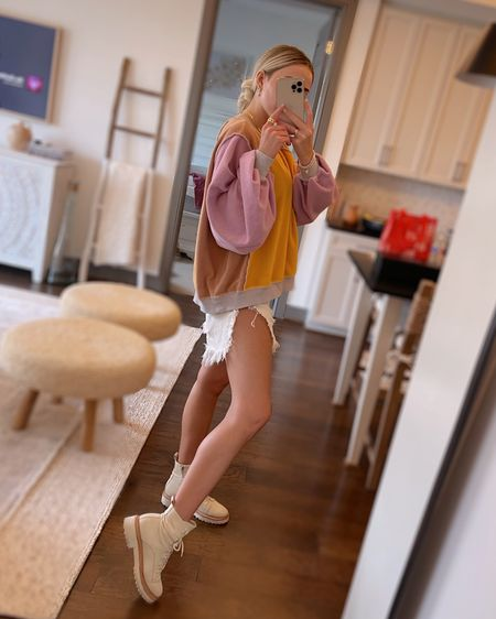 http://liketk.it/3cjsC @liketoknow.it #liketkit #LTKSpringSale #LTKshoecrush #LTKstyletip  free people pullover, one teaspoon denim shorts, dolce vita boots