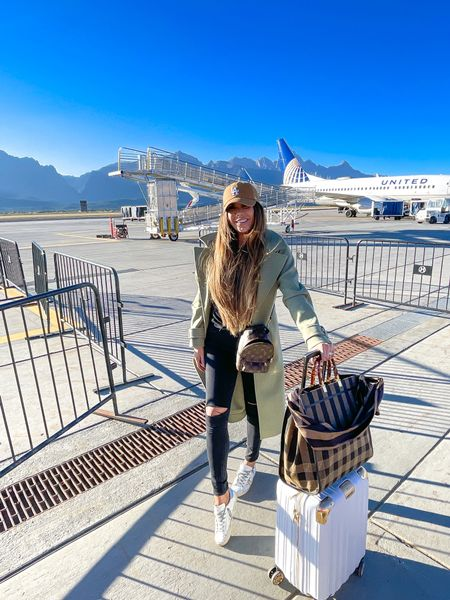 Emily Gemma Travel Style, Airport Outfit, Luggage, Gold and White Suitcases, Fendi Tote Bag, LA Ballcap, Green Coat, Affordable coat, Balmain, Golden Goose, Black Skinny Jeans, Emily Ann Gemma, Fall Outfit, Fall Fashion, http://liketk.it/3nJ6X
