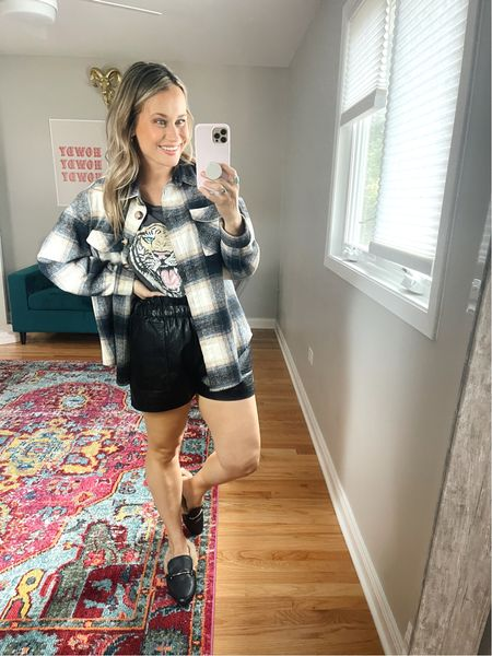 Outfit ideas! These faux leather shorts paired with a graphic tee and shacket is the perfect early fall outfit! Also linked these fuzzy mules, I love them!   #LTKstyletip #LTKshoecrush #LTKunder50