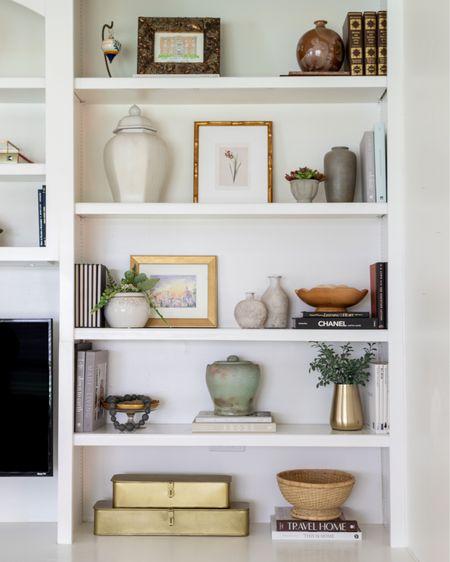 Bookshelf decor, shelf decor, built-ins decor, living room decor.  #liketkit @liketoknow.it http://liketk.it/3hPNT