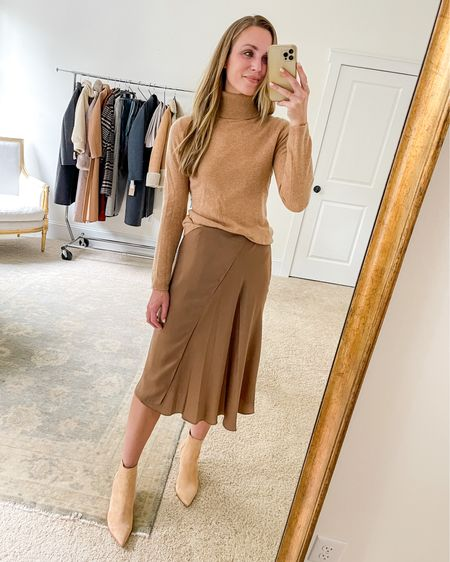 Tonal look for the office or another dressy occasion. Skirt runs large, exact sweater is by Garnett Hill and sold out—similar linked. Booties run TTS and are more peachy in person.  #fallworkoutfits #fallskirt #heeledbooties #heeledboots #fallskirtoutfit #tanbooties #fallworkwear
