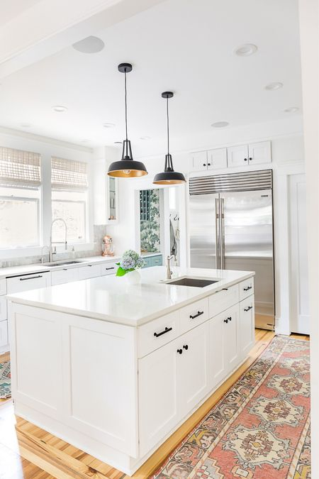 White kitchen accents: pendant lights and Turkish runners. Love these colorful touches to a white kitchen. #whitekitchen #homedecor #kitchendecor #luluandgeorgia #modernkitchen   #LTKhome