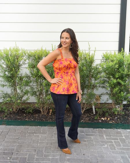 Fall outfit / casual outfits / orange floral print babydoll tank top / dark blue petite flared jeans / brown heels / gold bangles with pink stone / Kendra Scott earrings   #LTKunder100 #LTKunder50 #LTKSeasonal