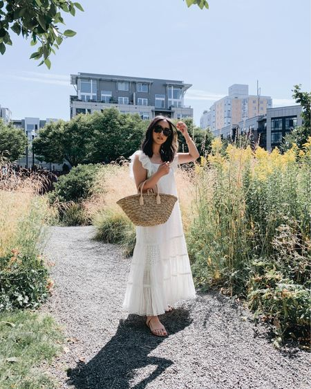 White eyelet maxi dress. White dresses for summer.   Dress - Anthropologie peote xxs (linked similar) Sandals - Kaanas 5 Bag - Mango  http://liketk.it/3eMNW #liketkit @liketoknow.it #LTKshoecrush #LTKstyletip