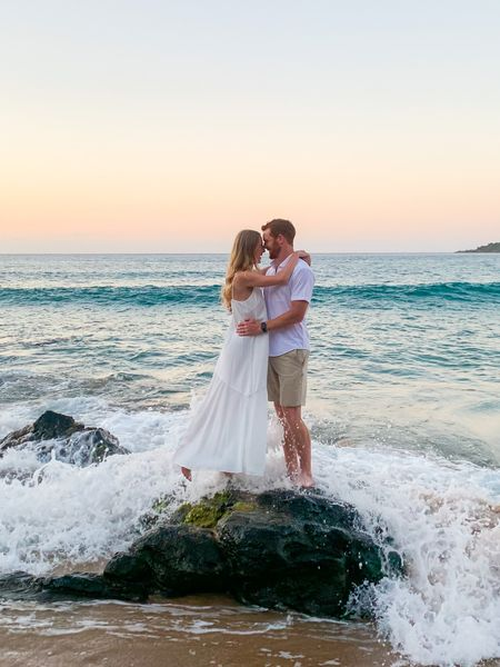 Long white flowy maxi dress with a slit for sunset honeymoon pictures on the beach. I got mine in a boutique in Hawaii and tagged a few similar styles to recreate this look!  #LTKwedding #LTKunder50 #LTKtravel