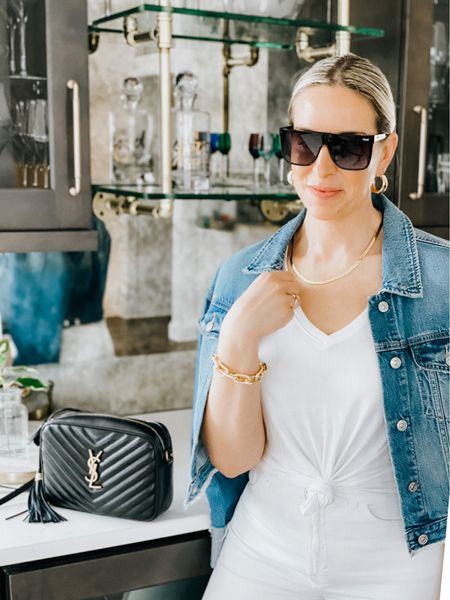 Favorite white tee is on sale for $14.25!  It's so soft, a little longer in length to tie to perfect knot. Comes in multiple colors.   Quay shield style sunglasses   YSL camera bag  White t-shirt, Abercrombie and Fitch, classic style, capsule wardrobe, holiday weekend look.     #LTKsalealert #LTKstyletip #LTKtravel