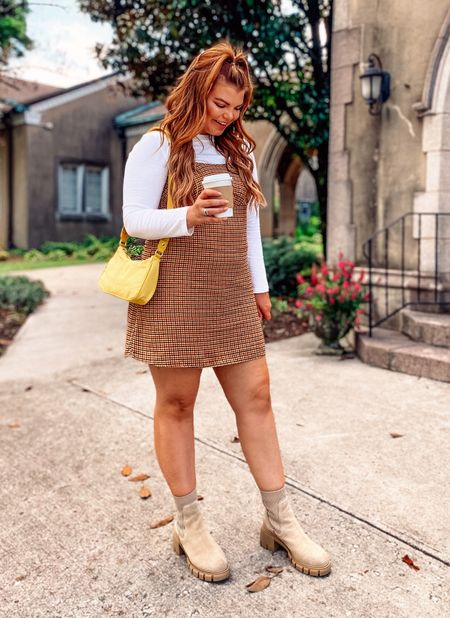 Layering for Fall is my favorite. This dress is so great for the in between months and is $15. Runs small so go up! I'm in a large. Tee is $8 and is so great to throw under dresses like this. I'm in a medium TTS. Bag is $20 and linked.   #LTKstyletip #LTKcurves #LTKunder50