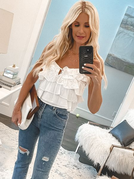 Easy breezy under $50 summer top! Jeans, bag, and shoes are also under $100! Wearing an XS in the top and a 0 reg in the jeans.   #LTKstyletip #LTKunder50 #LTKunder100