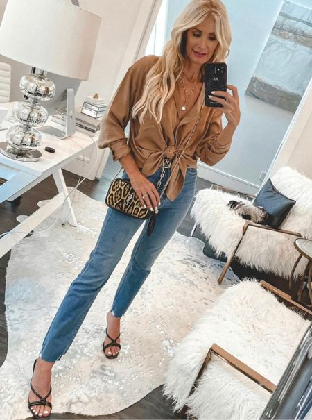 SALE ALERT! In love with this Under $100 satin boyfriend shirt! My jeans and heels are also on sale. I sized up one size in the top, I'm wearing a small.   Follow my shop on the @shop.LTK app to shop this post and get my exclusive app-only content!   #LTKsalealert #LTKunder50 #LTKstyletip
