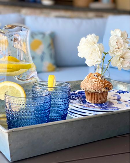 Serving up some beautiful blues this summer on the patio.    Outdoor sofa.  Serving Ware.  Blue Glasses.  Blue Drink Ware.  Floral Plates.  Salad Plates.  Appetizer Plates.  Glass Pitcher.  Water Pitcher.  Serving Tray. Entertaining outdoors.     #LTKhome #liketkit @liketoknow.it @liketoknow.it.home http://liketk.it/3ixix
