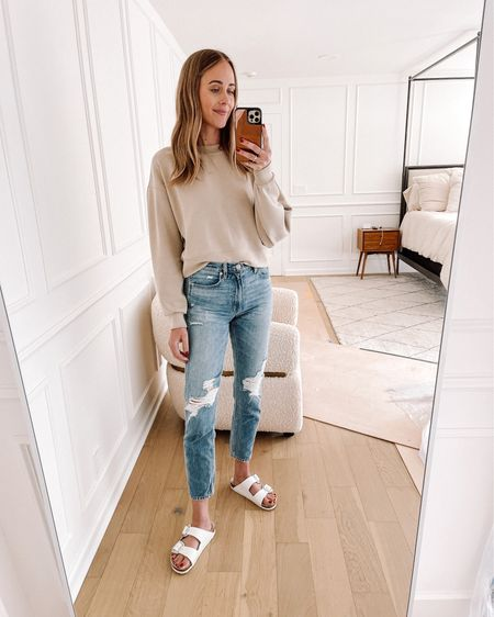 Love this sweatshirt from lululemon - it's SO soft (tts / 4) and my ripped jeans from Shopbop and white Birkenstock sandals (tts) comfy and casual #summeroutfit