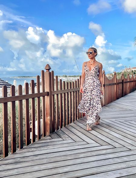 As far as I'm concerned leopard is a neutral. . Off for sunset drinks in Providenciales and an early one before tomorrow's busy day: morning jet ski tour and evening glow worm tour. . Pink tiered maxi dress @renttherunway @hutch_design Gold layered necklace @ettika Sunglasses @jimmychoo Bag @amazonfashion Wide gold bracelet cuff @girlfriendbox . #providenciales #tci #igtravel #turks #travelblogger #travelblogging #ltksummer #renttherunway #ettika #hutch   #LTKtravel #LTKitbag #LTKwedding