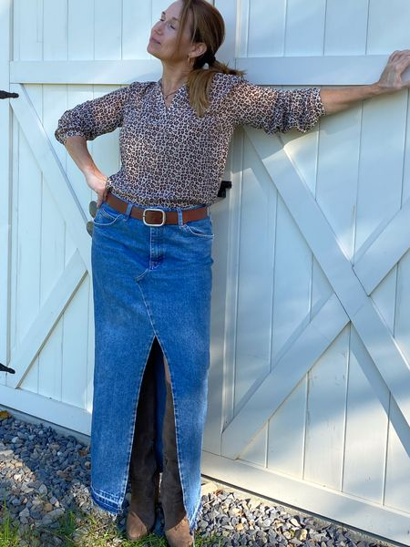 Denim is the perfect transitional material. As is a leopard print blouse, tall suede boots, and Ray-Ban  #LTKFall #LTKstyletip