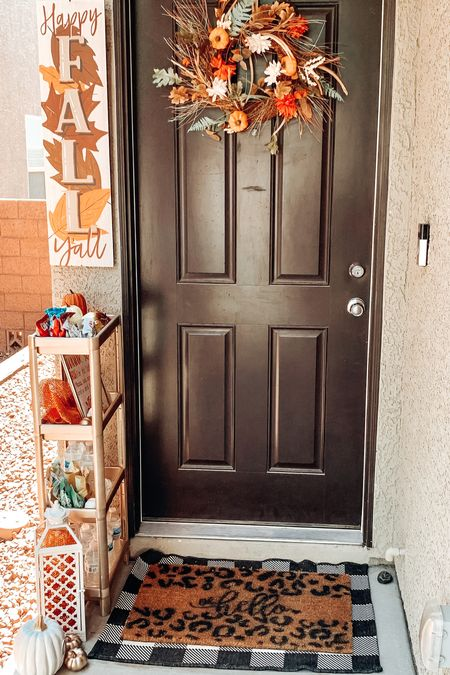 Fall porch is complete 🍂  I set up a cute shelf system for gifts and treats that the delivery drivers can take! Linked my rug and doorbell as well!   #LTKSeasonal #LTKHoliday #LTKGiftGuide